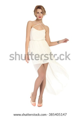 Beautiful girl in dress on the white background