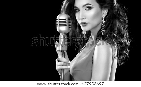 Beautiful Girl in karaoke. Woman with Microphone. black and white