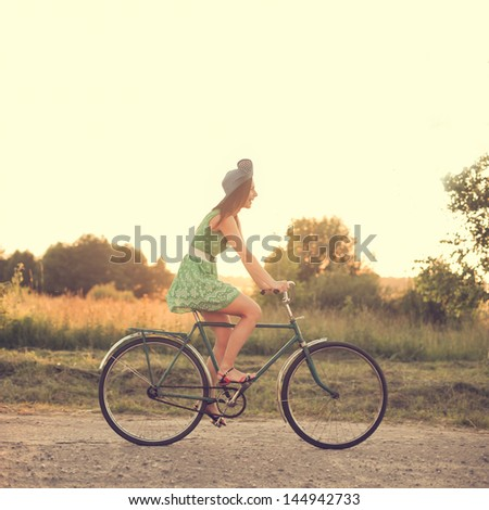 beautiful girl on a vintage bike