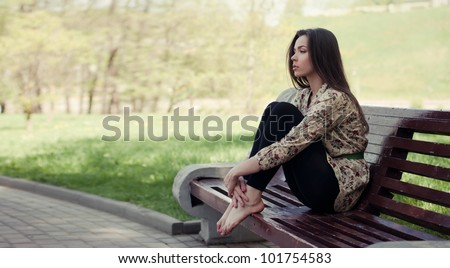 Beautiful girl sitting on the bench