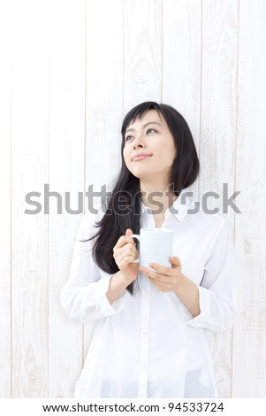 beautiful girl with a cup of coffee