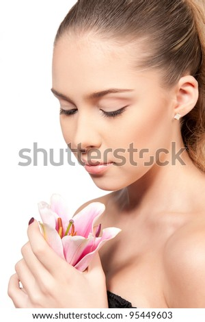 Beautiful girl with a lily on an isolated background