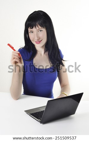 Beautiful girl with black hair works for laptop