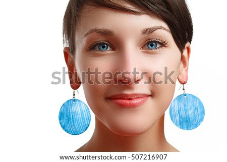 beautiful girl with blue eyes and earrings, on white background, isolated