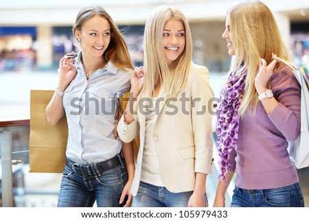 Beautiful girls with shopping bags in shop
