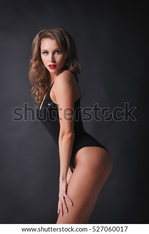 Beautiful glamourous girl dancer dressed in black bodysuit