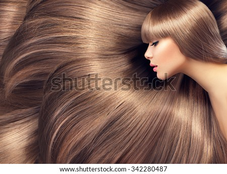 Beautiful Hair. Beauty woman with luxurious long hair as background. Beauty Model girl with Healthy blond Hair. Beautiful woman with long smooth shiny straight hair. Hairstyle. Hair cosmetics