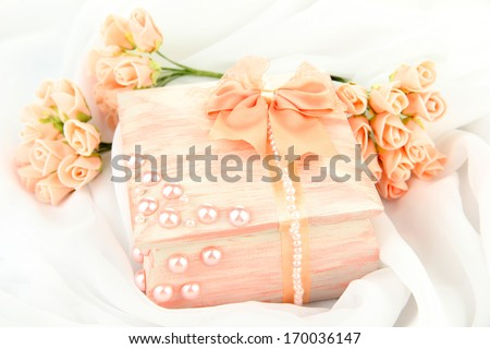 Beautiful hand made casket and flowers, isolated on white cloth background