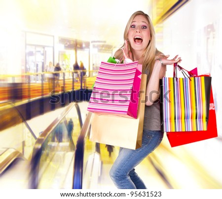 Beautiful happy blond girl with shopping bags