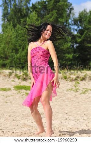 stock photo beautiful happy woman dancing on the beach 15960250