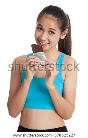 Beautiful healthy Asian girl eat chocolate  isolated on white background
