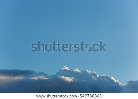 Beautiful, heavy clouded blue sky background.
