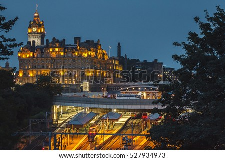 Beautiful historical core of Edimburg, Scotland, United Kingdom, Europe during a night. Capital of Scotland, university city, parliament, clock tower, Princes street, train station.