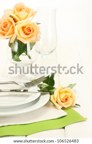 beautiful holiday table setting with flowers