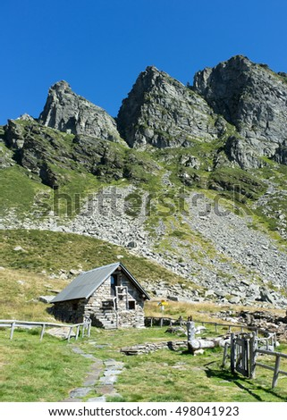 Beautiful hut in the swiss alps under a clear blue sky