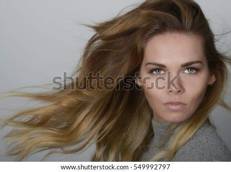Beautiful Image Of a Young woman on Grey with sweater