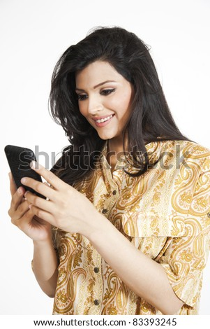 beautiful indian girl using a mobile phone, isolated on white
