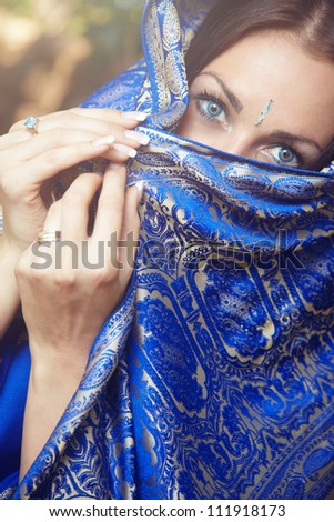 Beautiful lady in blue Indian sari outdoors