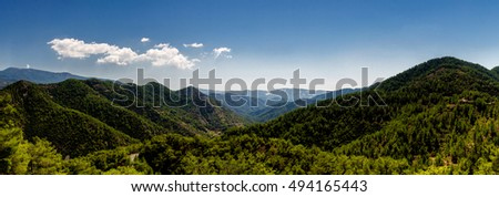 Beautiful landscape. Green hills and blue sky with white clouds. Panoramic photo