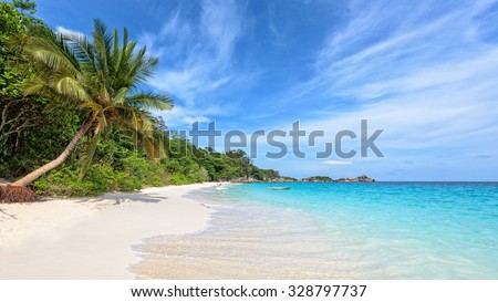 Beautiful landscape of blue sky coconut sea sand and waves on the beach during summer at Koh Miang island in Mu Ko Similan National Park, Phang Nga province, Thailand, 16:9 widescreen