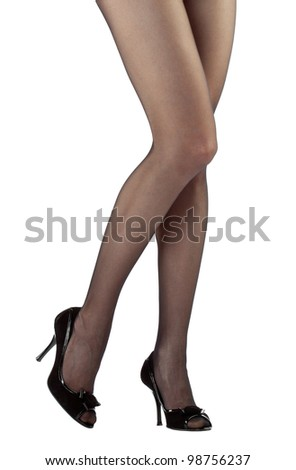 Beautiful legs of young woman isolated over white background