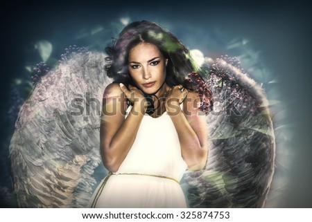 beautiful like angel young  woman with wings double exposure