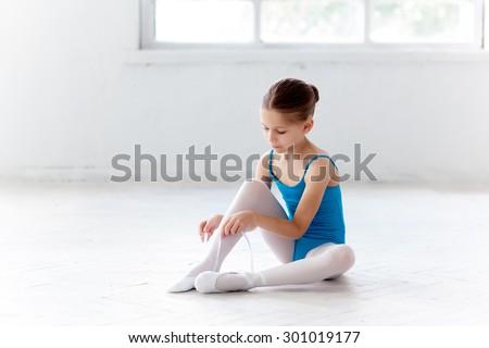 girl child practicing yoga stretching paschimottanasana