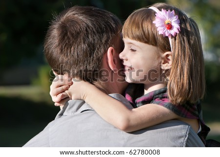 beautiful little girl hugging embracing her father