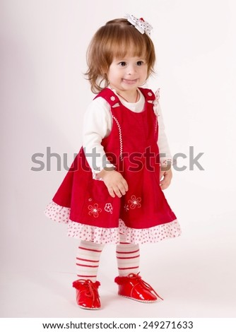 Beautiful little girl in dress in vintage style
