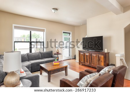 Beautiful Living Room In New Home With Couch, Television, Coffee Table,  Lamps, Part 72