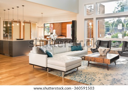 Beautiful Living Room Interior In New Luxury Home With View Of Kitchen.  Home Interior With Part 97