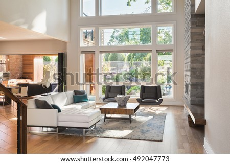 Beautiful Living Room Interior In New Luxury Home With View Of Outdoor Covered  Patio. Home