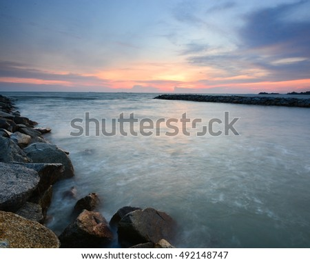 Beautiful long exposure shot of seascape at dusk. Soft focus due to shot at dusk. Composition of nature.