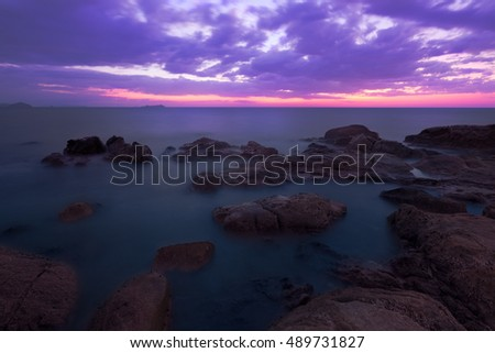 Beautiful magenta color of sunset sea during twilight