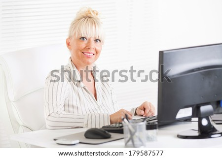 Beautiful mature Business woman working in the office