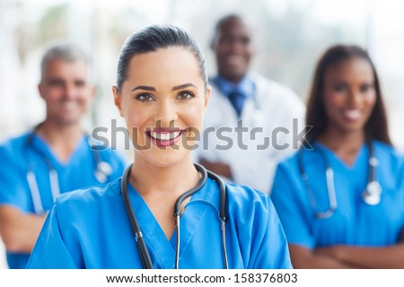 beautiful medical nurse and colleagues in hospital