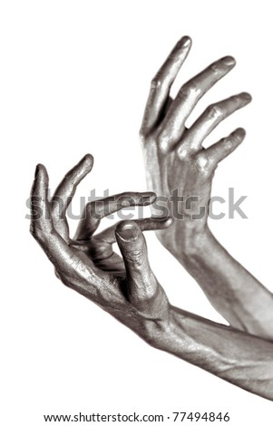 beautiful men metal hands with long fingers on white background