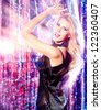 Beautiful modern girl dancing at the party. Disco lights. - stock photo