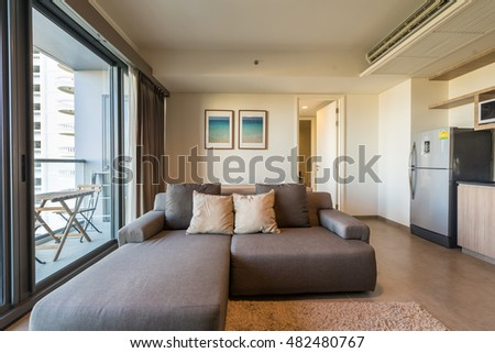beautiful modern living rooms. Beautiful modern living room interior with blue sofa and good view of  balcony Modern Openplan Apartment Living Room Foreground Stock Photo