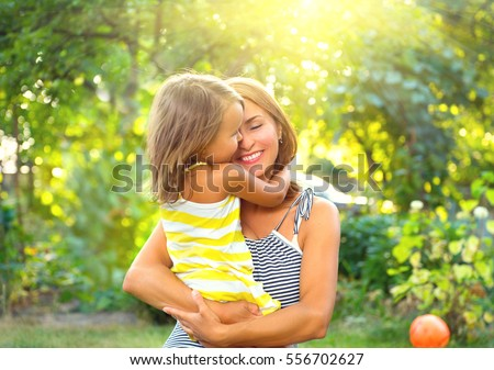 Beautiful Mother And her little daughter outdoors. Nature. Beauty Mum and her Child playing in Park together. Outdoor Portrait of happy family. Happy Mother's Day Joy. Mom and Baby.