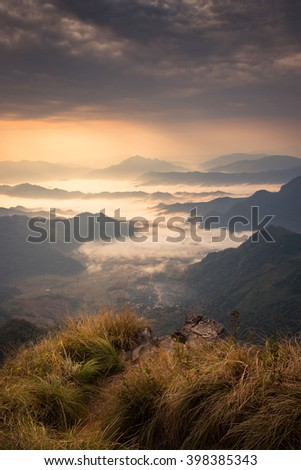 beautiful mountain in the morning with warm sunlight and fog