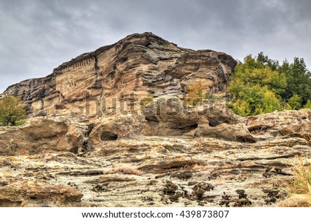 Beautiful mountain landscape with ancient rock monastery