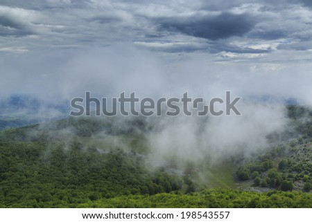 Beautiful mountain scenery in the Alps in summer and storm clouds