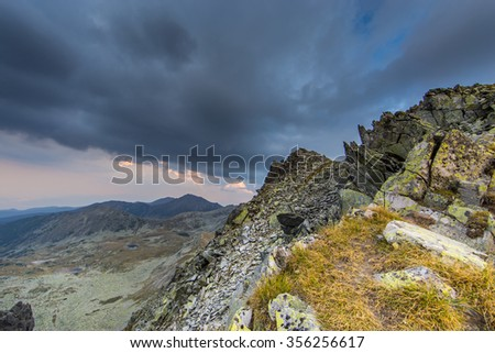 Beautiful mountain scenery in the Transylvanian Alps with storm clouds, in summer