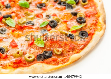 Beautiful multi colored and crispy pizza with basil, melted cheese and