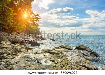 Beautiful natural summer seascape and stone with in blue sky and flare