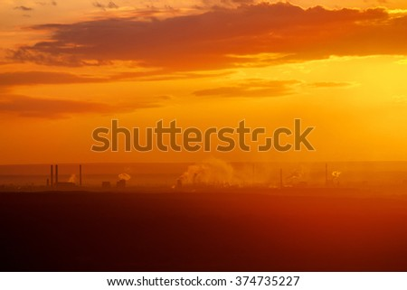 Beautiful nature landscape. Silhouette of Industrial factory