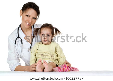 Beautiful nice nurse with a girl sitting on a table on a white background