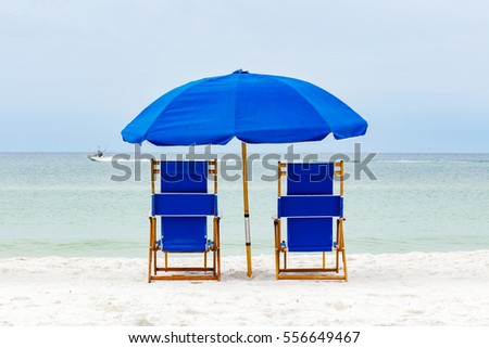 Beautiful North Florida panhandle beach with lounge chairs and umbrella.