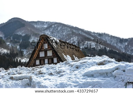 Beautiful old wooden house in big white snow